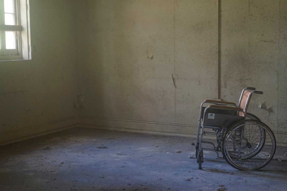Wheelchair in bare room
