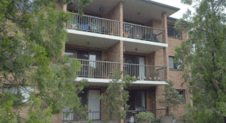 Larger than average living area, top floor unit with two bedrooms & a single lock up garage