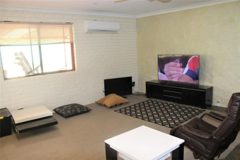 MODEST FAMILY HOME WITH SOLAR AND CLOSE TO ALL AMENITIES