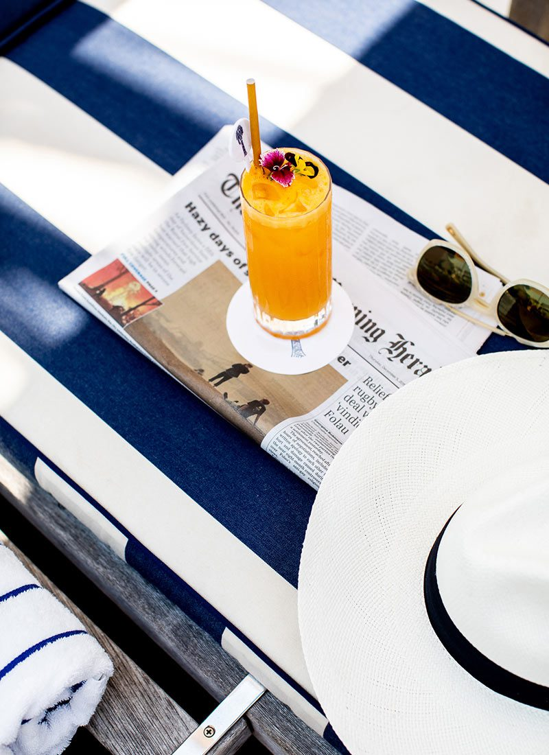 Cocktail by the pool at Halcyon House